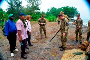 UK soldier demonstrates to President, High Com Deborah Stokes & Torokina MP Steven Suako